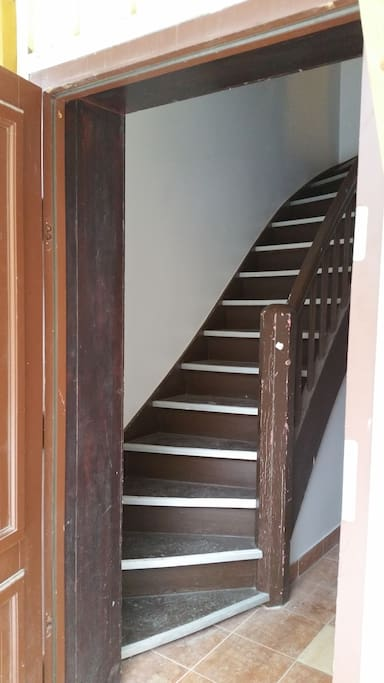 there is a staircase up to the apartment located on the 1st floor