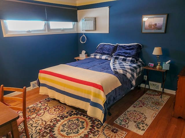 Hardwood floors with area rugs. Air conditioned. Room-darkening shades.
