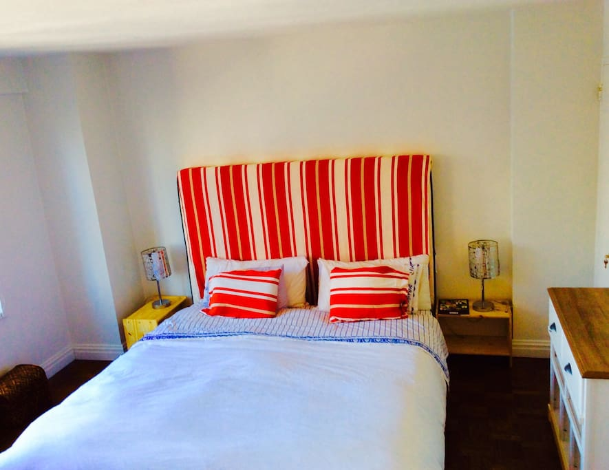 The bedroom with a king size bed and in front is a special fa that turns in a Queen size bed, very comfortable, special for couples, or family with kids!