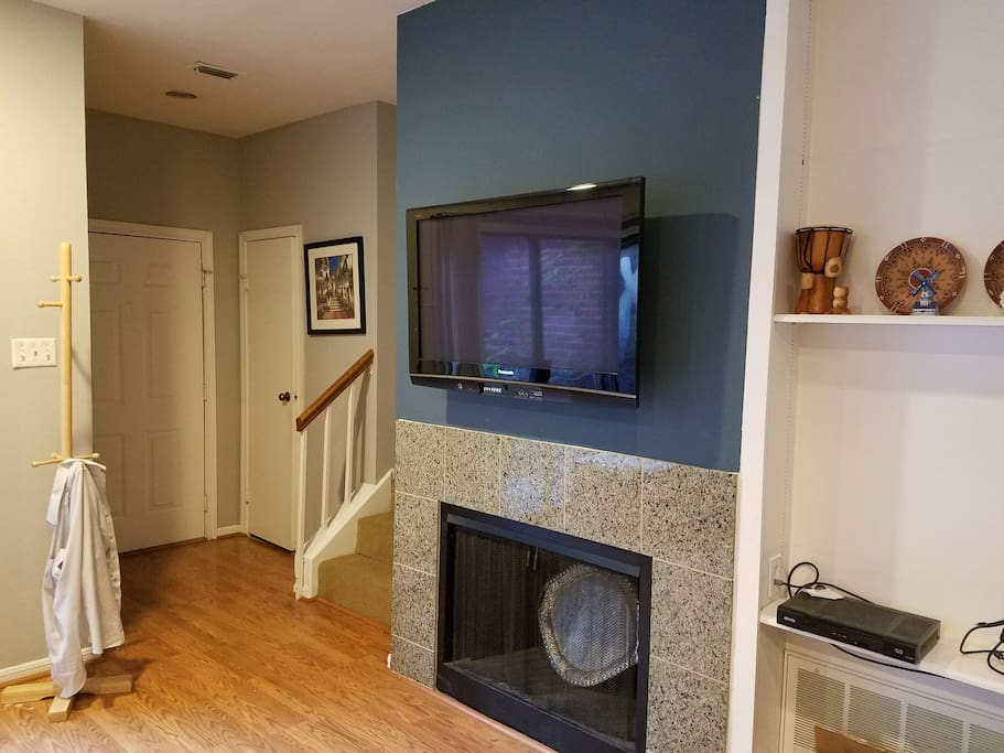 Sit down to a movie or watch the game. The fireplace works too (not that Houston allows for it much)