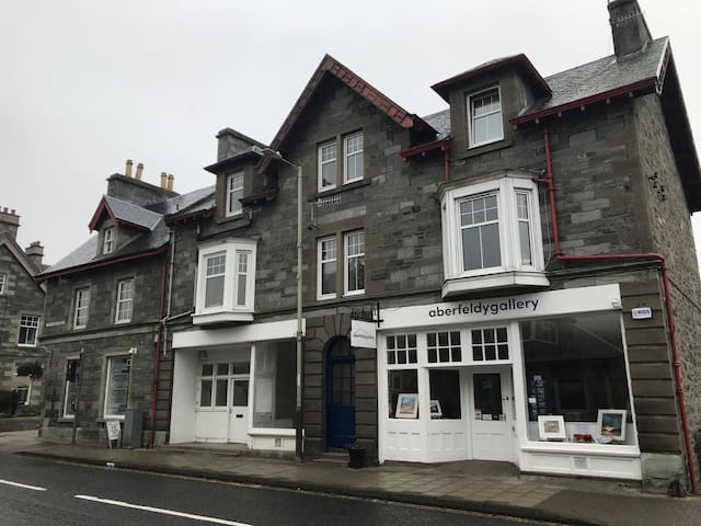Kynachan, 5 Kenmore Street. Your double room awaits through the blue door up the stairs on the left. Right in the centre of Aberfeldy.