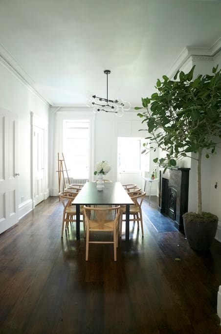 The living room opens up to the garden and there is art and a beautiful mirror coming for above the fireplace. It's connected to the kitchen and living room