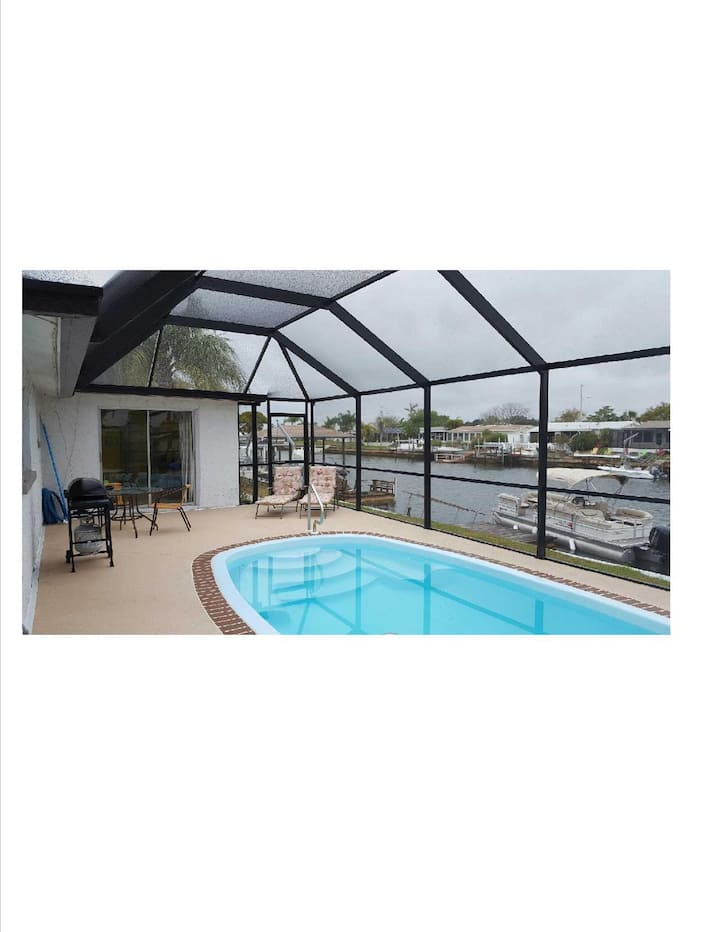 2 bedroom home direct gulf access, heated pool