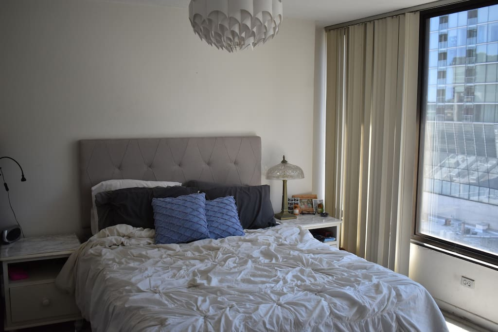 Master bedroom: queen memory foam bed, floor to ceiling windows and blinds, beautiful views of downtown Chicago