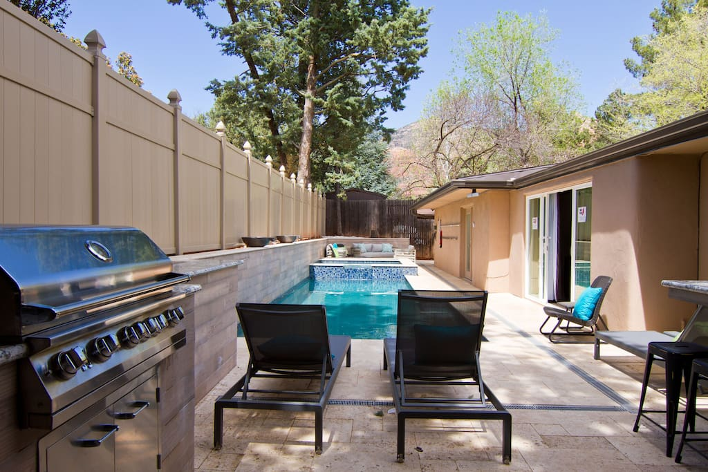 Newly built pool with jacuzzi and outdoor kitchen.