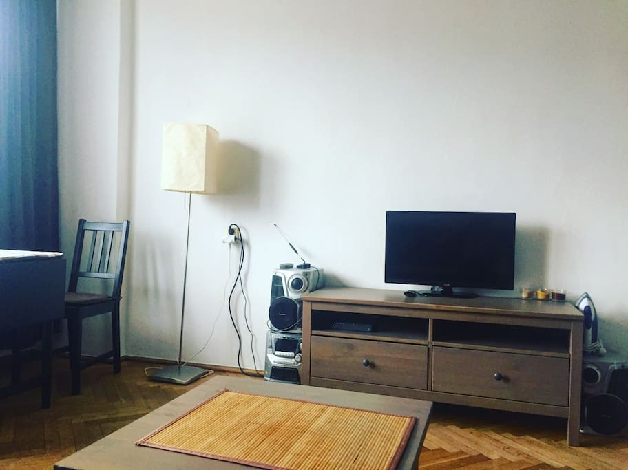 Private room with TV, table and workspace