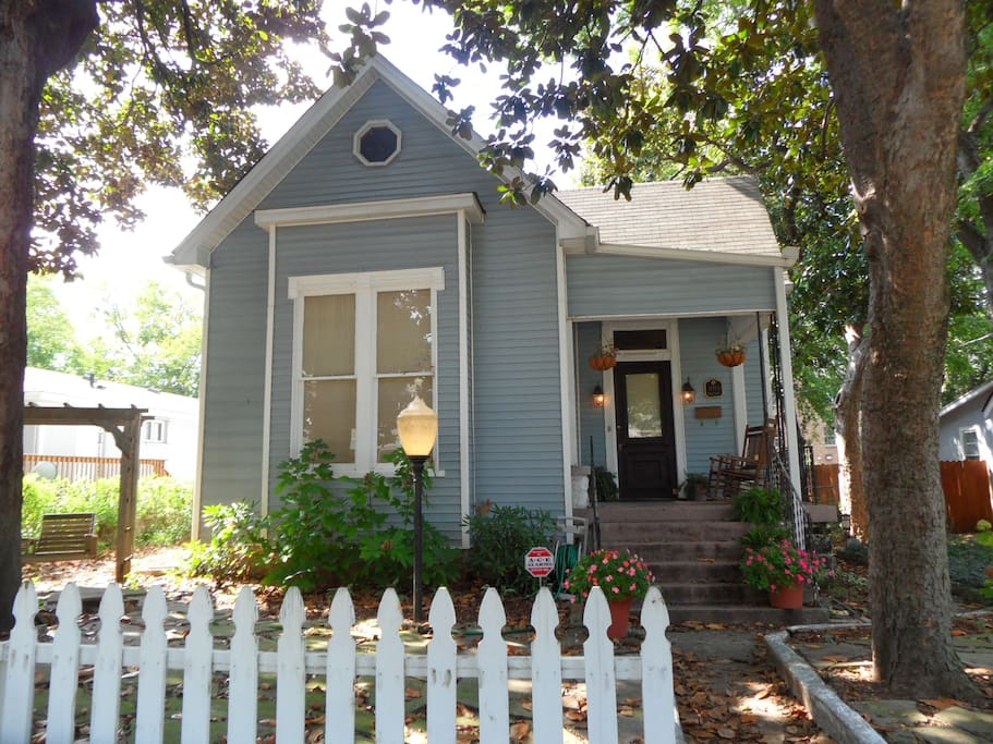 Adorable historic home with white picket fence and front porch