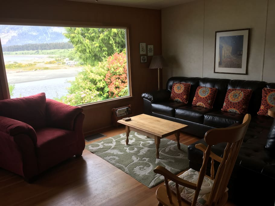 Large picture window and new furniture from which to enjoy the view.