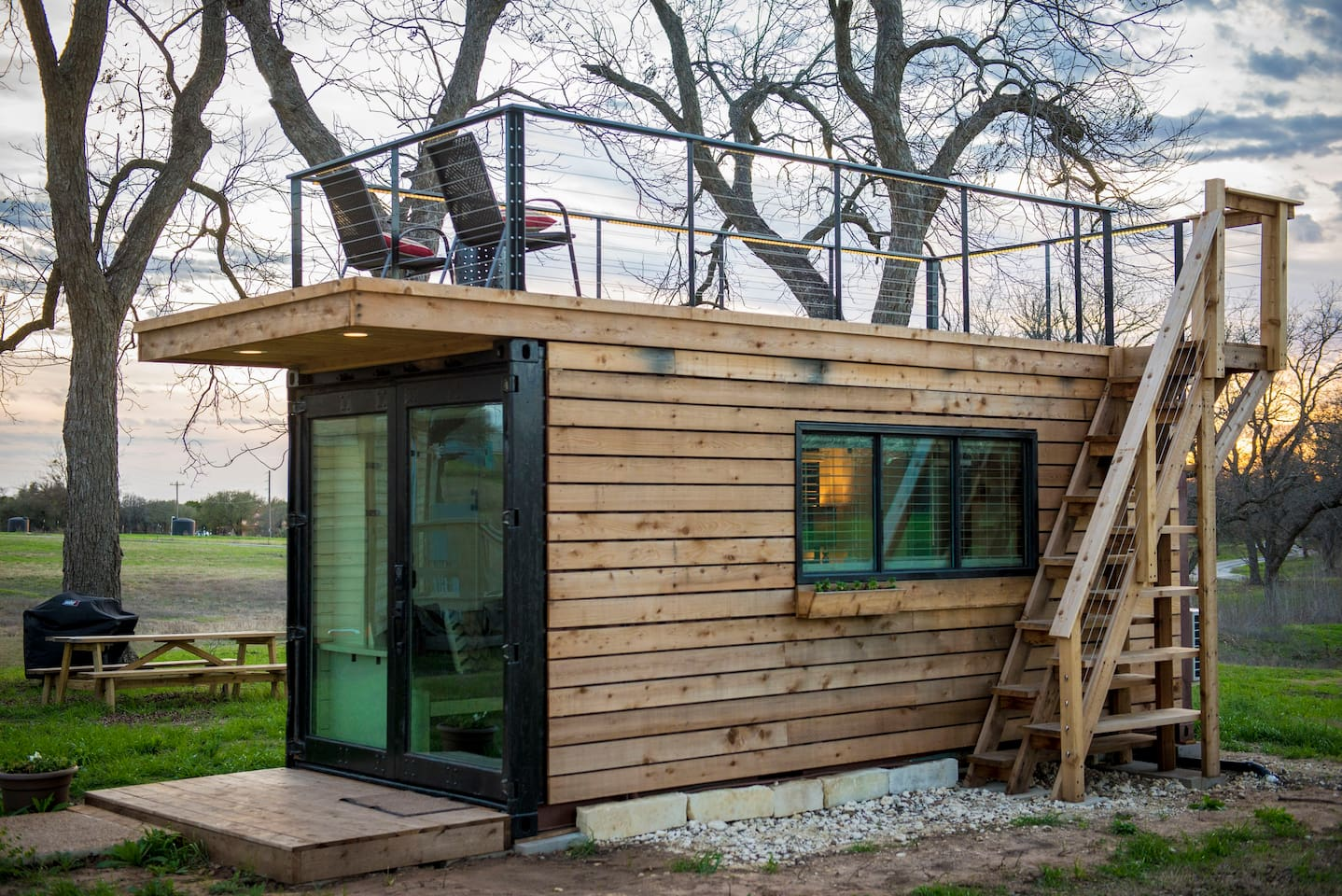 "20' Container home tiny house with upper deck, ""The Anchor""."