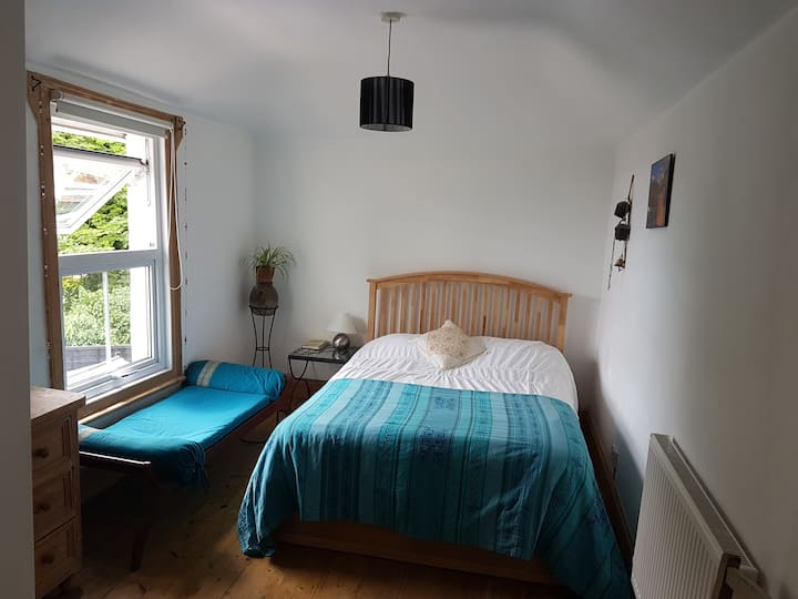 Light and peaceful double room & ensuite shower.
