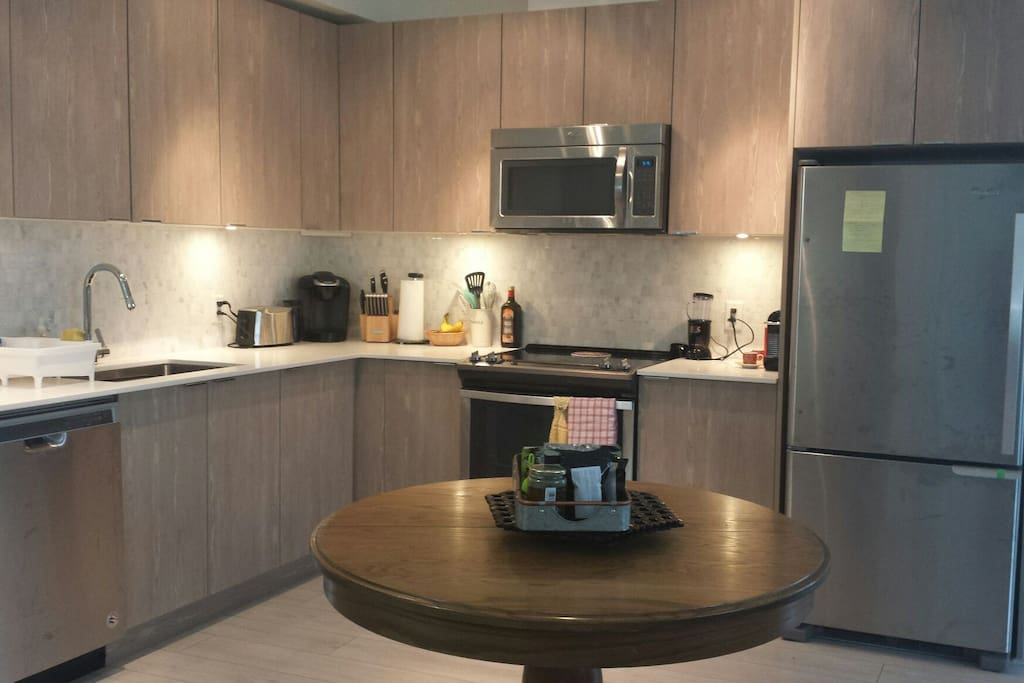 Shared kitchen and living space. Complimentary tea and coffee for guest use.