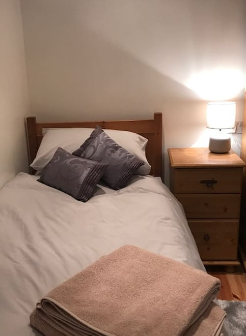 Full size single pull out mattress under neath single bed, with sturdy stands so is same level as single bed to create a comfy double if required.
