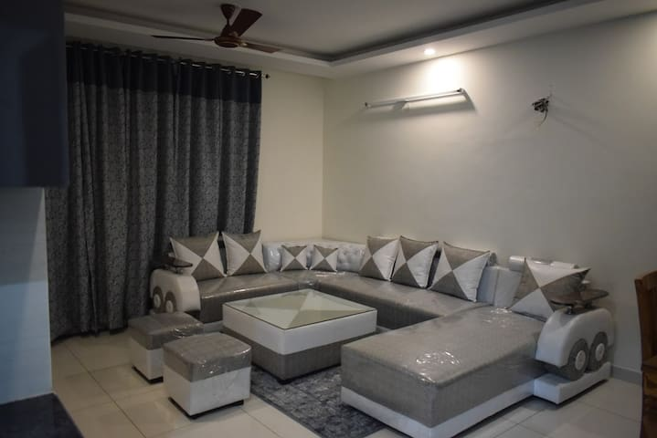 Living room with seven seater sofa set and one couch.