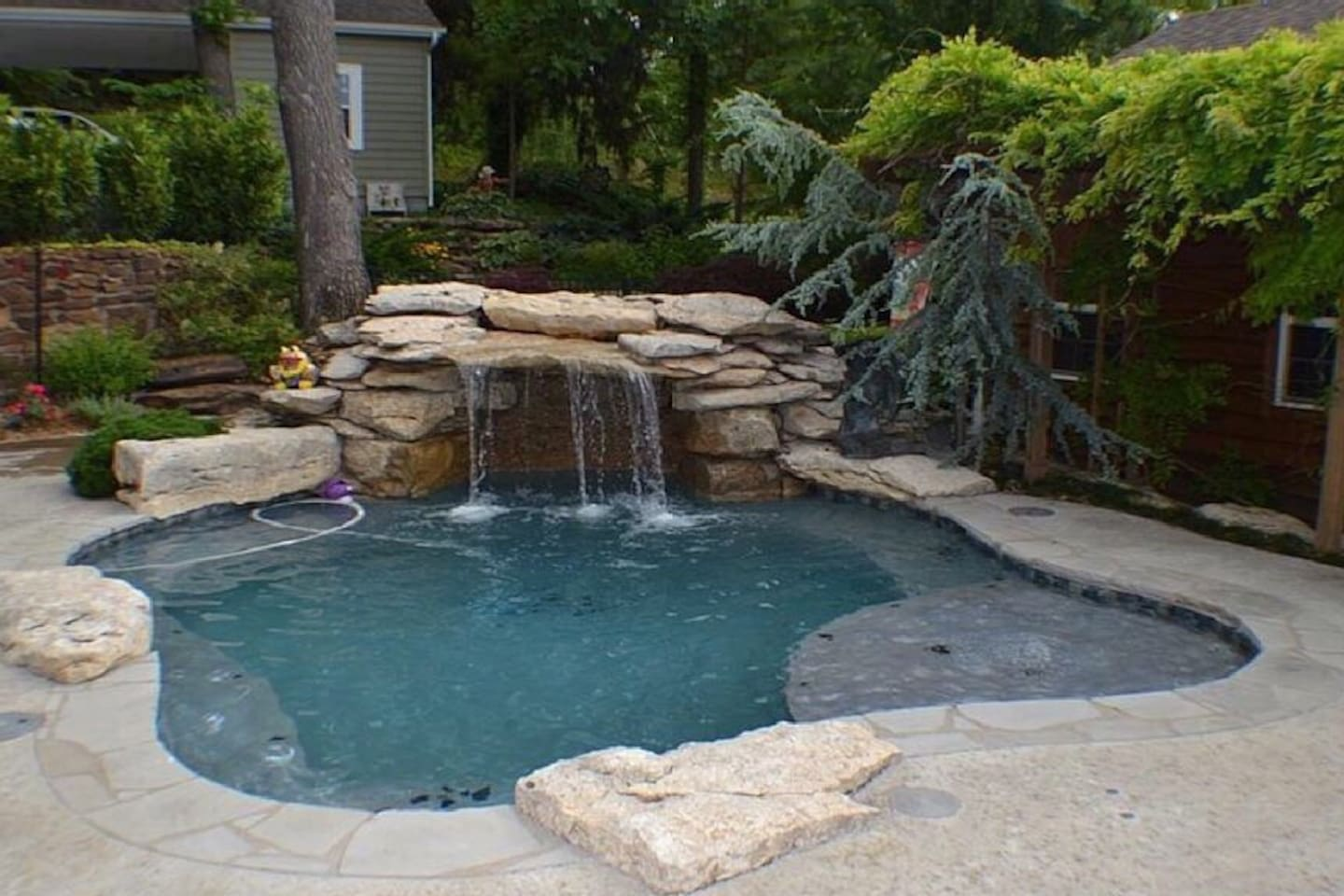 Private Pool with sitting area and waterfall