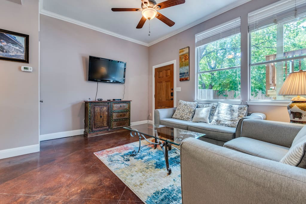 Relax in the elegant living room with lots of natural light and 46 inch flat screen TV