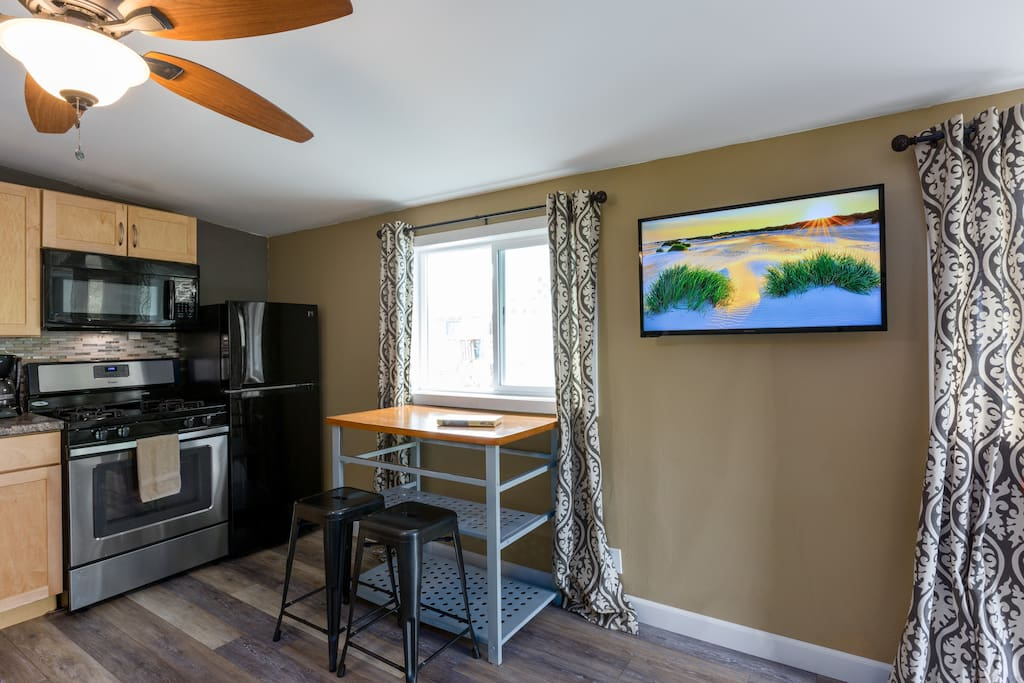 A smart tv and dining table