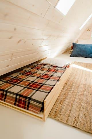 Twin trundle in loft space
