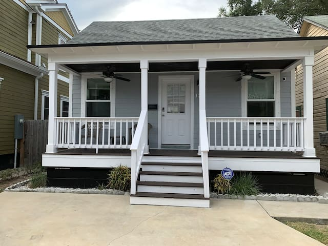 Front of house with porch and patio furniture