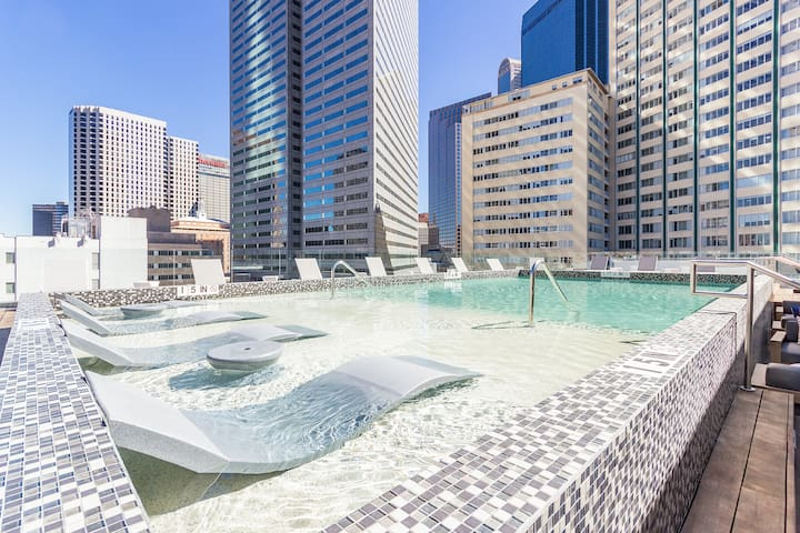 Rooftop pool overlooking downtown Dallas also one of the few places the pool stays open till midnight on weekends