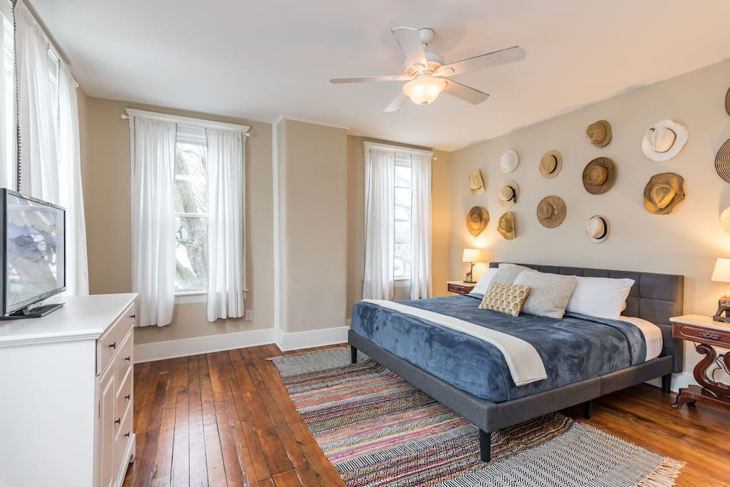 The master suite is no joke!  Plentiful storage and stylish furnishings surround this ultra comfortable king bed.  Windows all around overlook the spacious back yard.