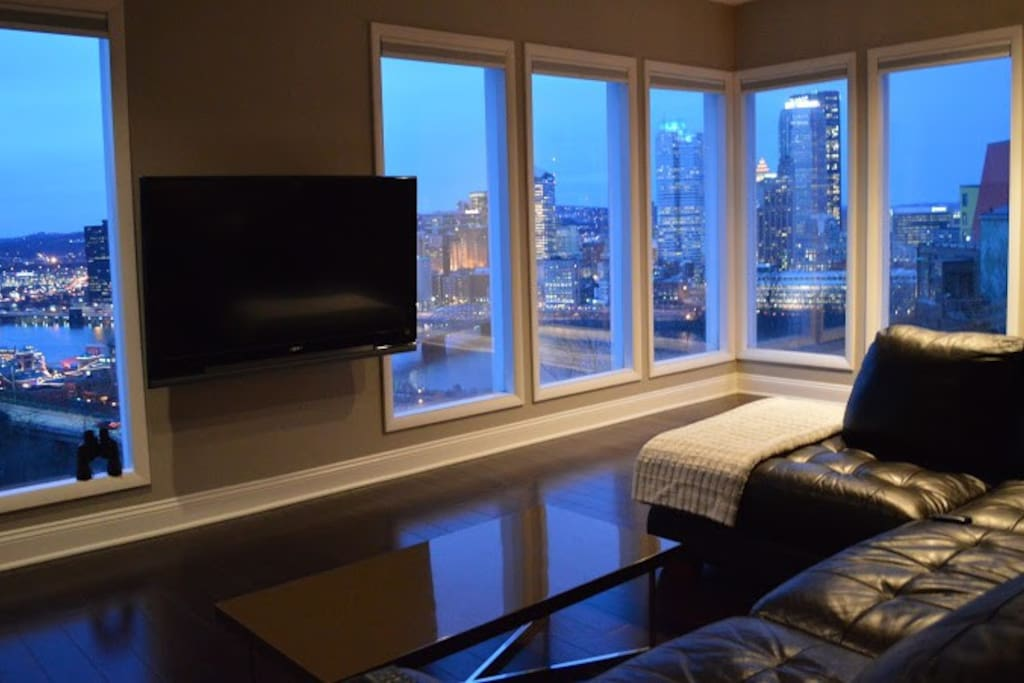 Walls of windows allow you to watch the city buzz from the comfort of your couch.