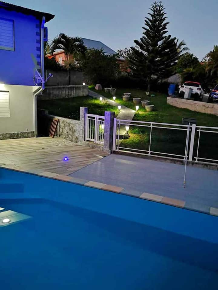 Apartment with 2 bedrooms in Lamentin, with wonderful mountain view, shared pool, enclosed garden - 10 km from the beach