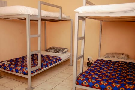We have 4 Bed Dormitories for females and for Males. Our rates are the lowest in the city but our service and quality of experience is priceless. Comfy bedding, Clean Rooms and Showers are standard.