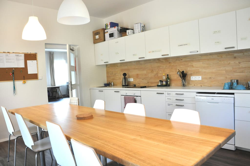 Nice shared kitchen with a large social room. You can use also outdoor seating for nice breakfast or dinners.