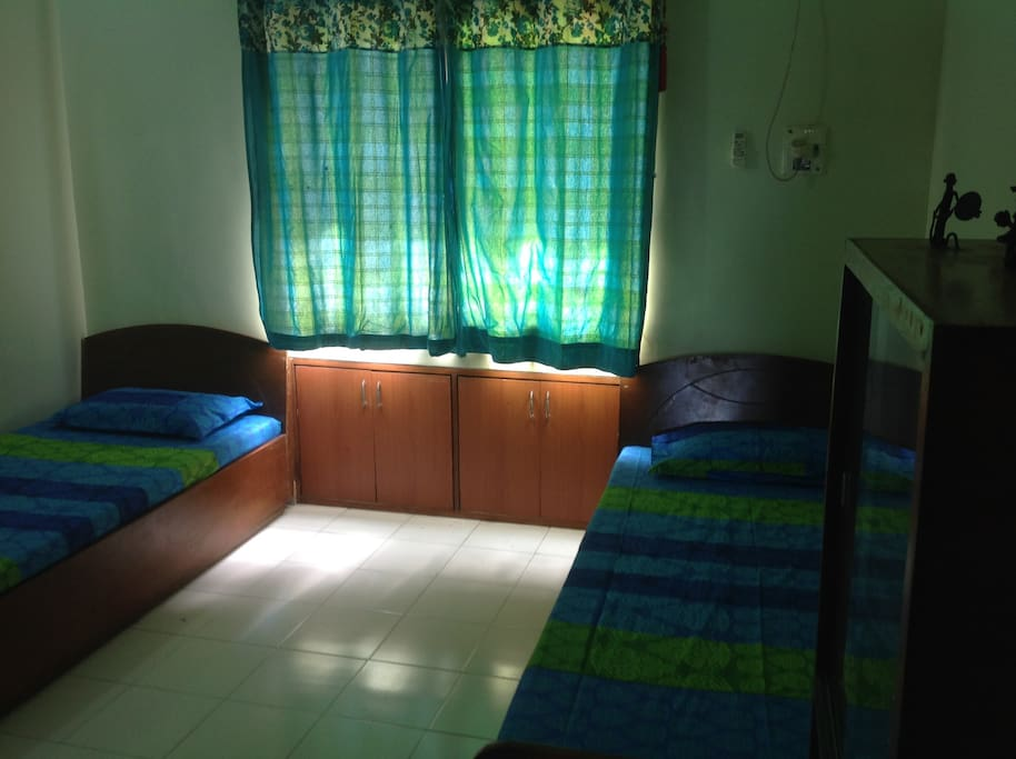 Bedroom with two single beds - they also can be joined!