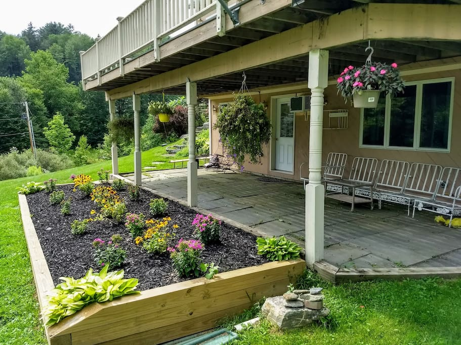 Private ground floor outside entrance with bluestone patio and front lawn.