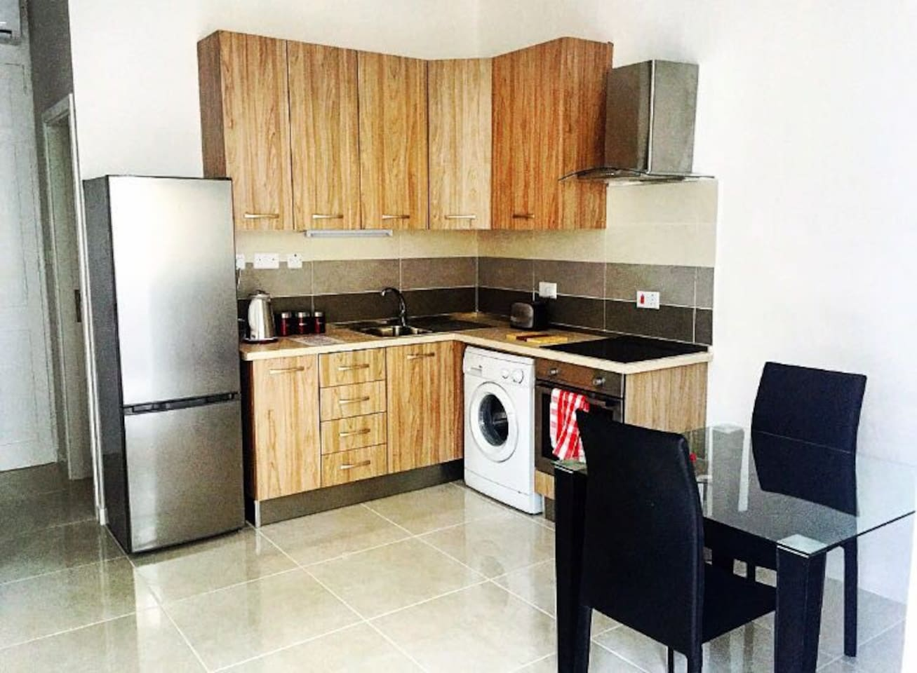 cozy kitchen with all equipment that u might need and dining table