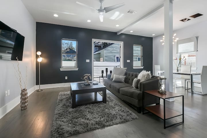 Cozy and chic living room with 55in smart tv equipped with cable. Huge french doors leading out to the deck