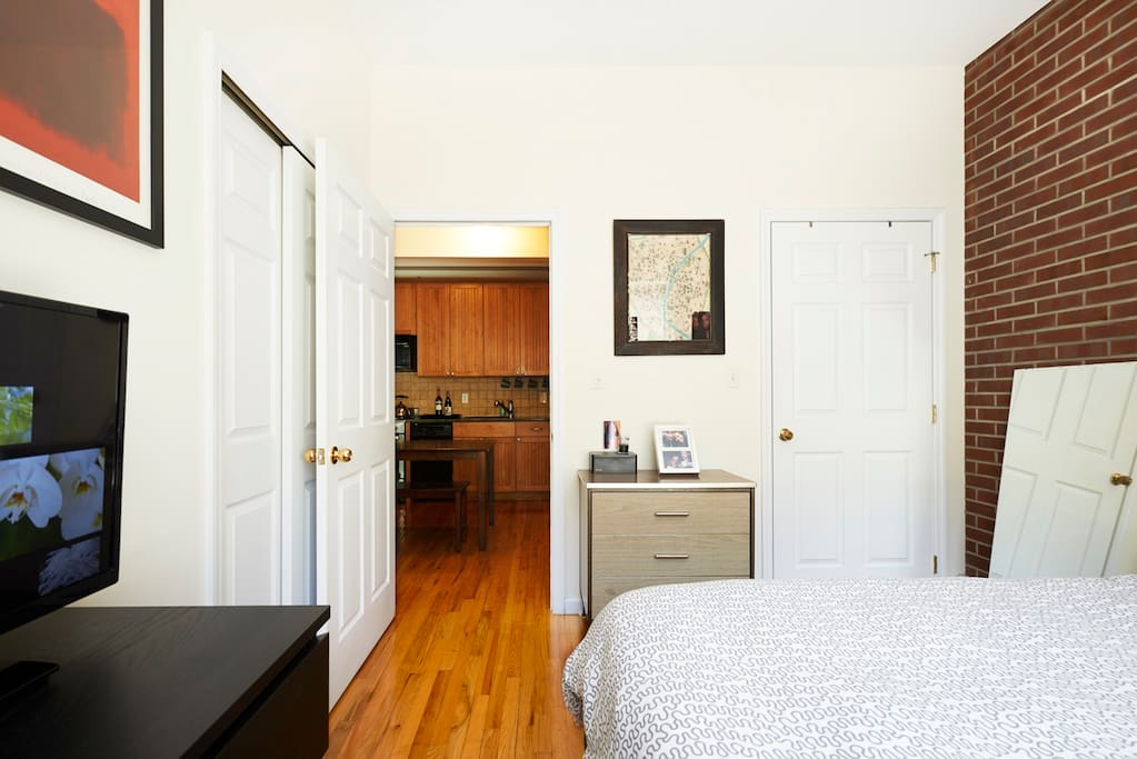 Bedroom with closet and TV, opens to Kitchen/Dining