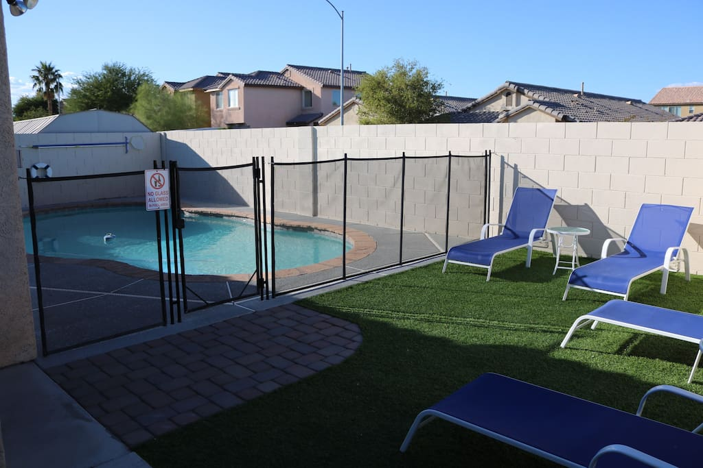 Swimming pool with gate and lounge
