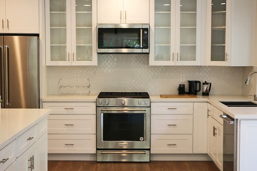 Beautiful new kitchen with gas stove.