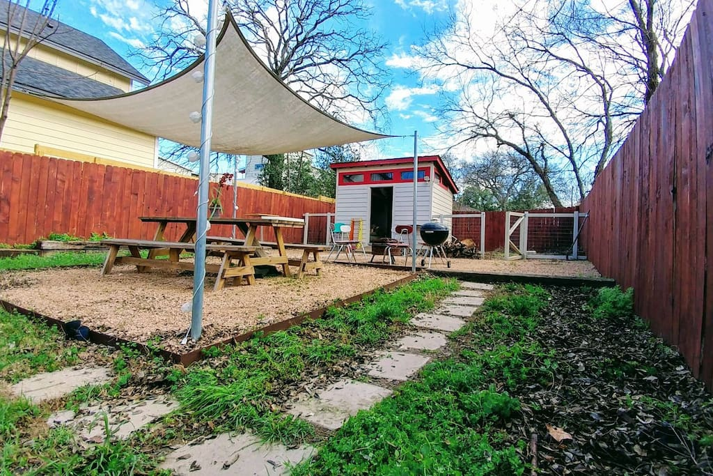 Tiny home has a great yard and hand area out front!