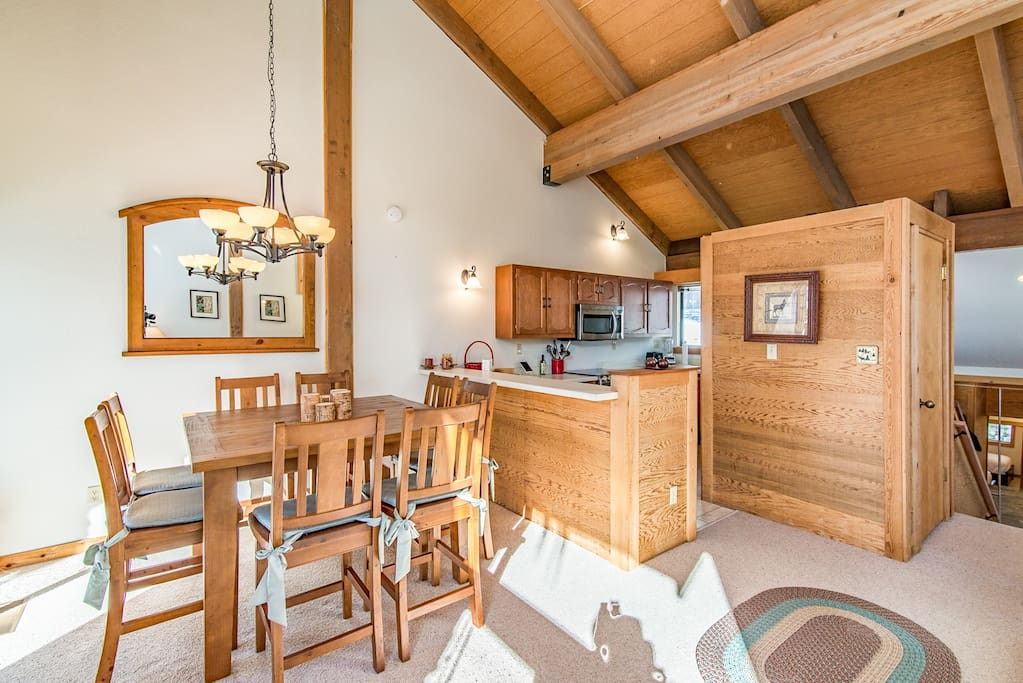 The airy and bright living room is open to the kitchen and dining area.