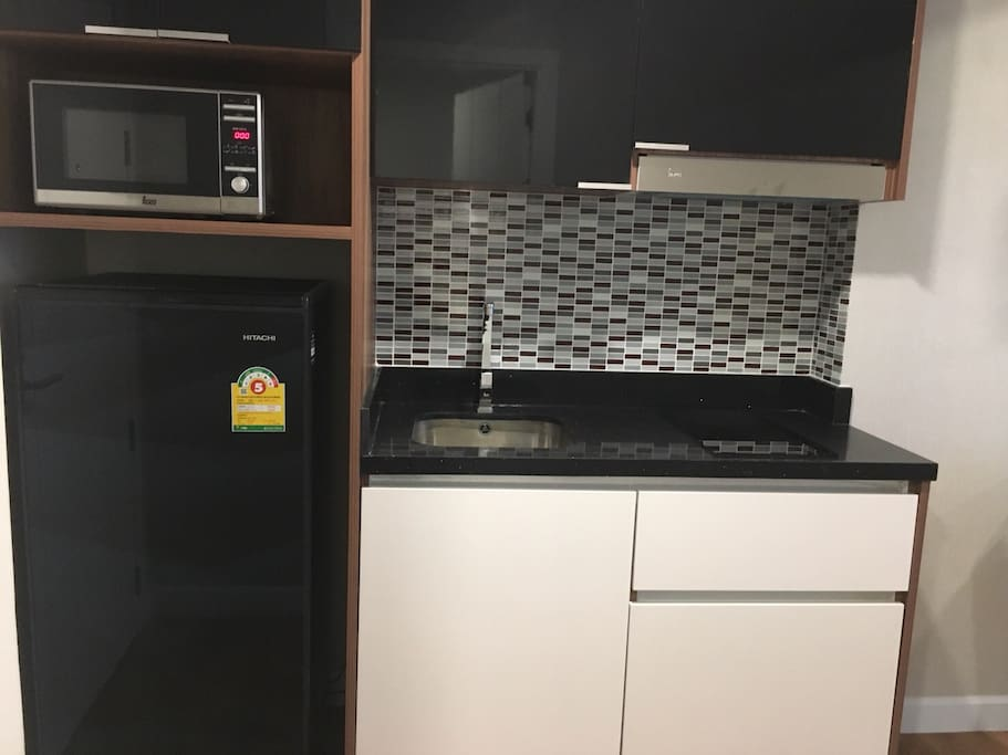 Microwave, Large Fridge and Double Hob Cooker.