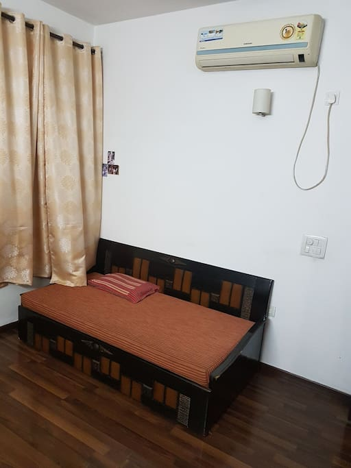 another view of room. Bed is extendable. Air conditioner is installed.