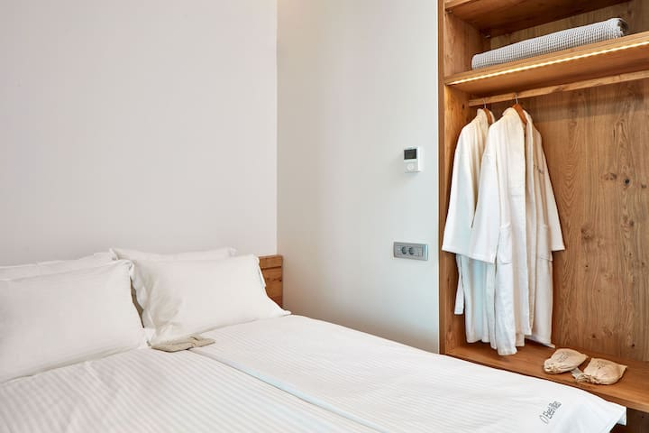Bedroom with a double bed and en-suite bathroom on the ground floor