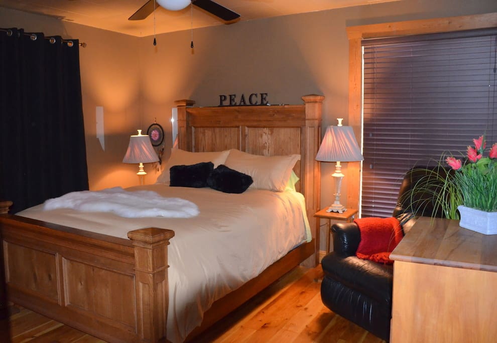 New Queen Bed! Very Comfortable. Feather Douvet feels like heaven. Cozy pillows Leather Reclining Chair, Dresser Mirror...