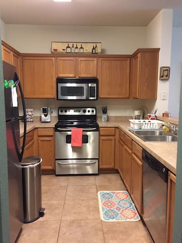 Full kitchen with dishes, pots/pans and silverware