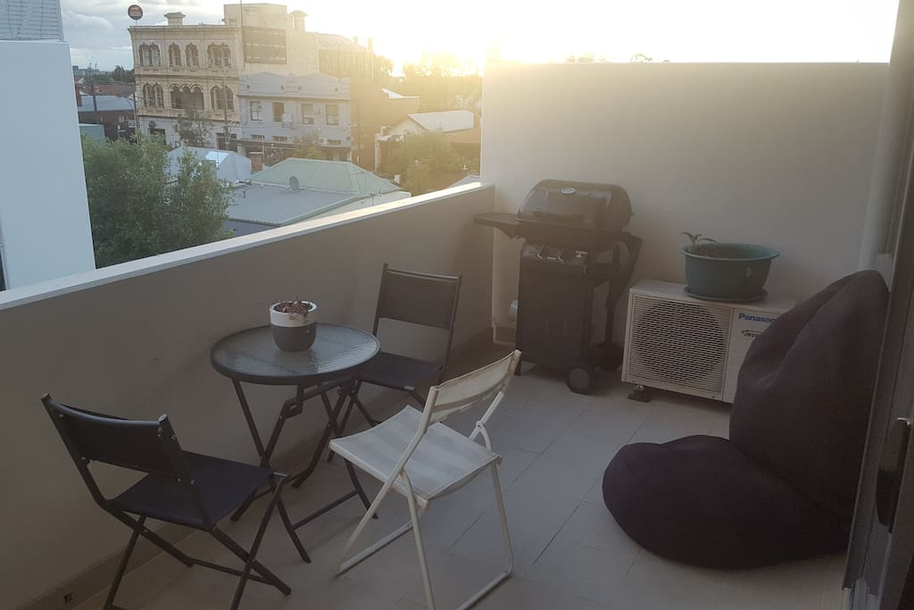 Balcony, outdoor setting & BBQ.