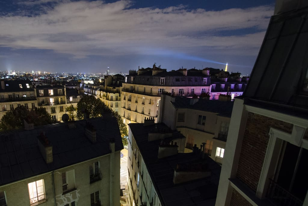 Night view over the roofs of Paris from the living room