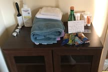 welcome wagon--we have plenty of towels and will set you up with toiletries for your first few days