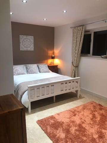 The front light airy bedroom with champagne tones