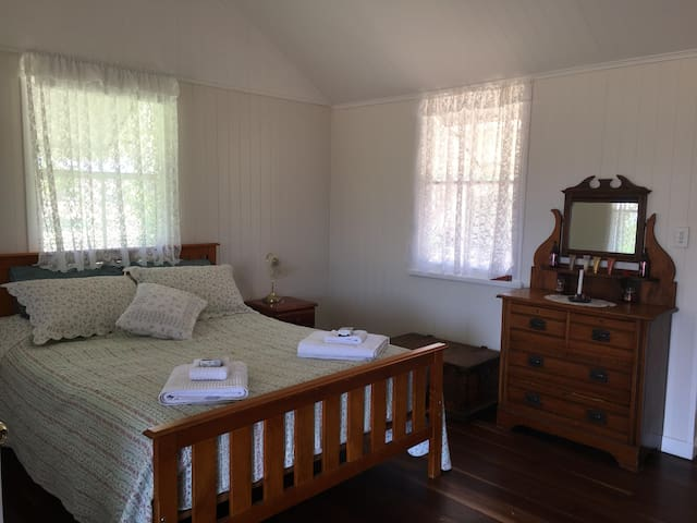 Spacious bedroom with queen bed & linen provided