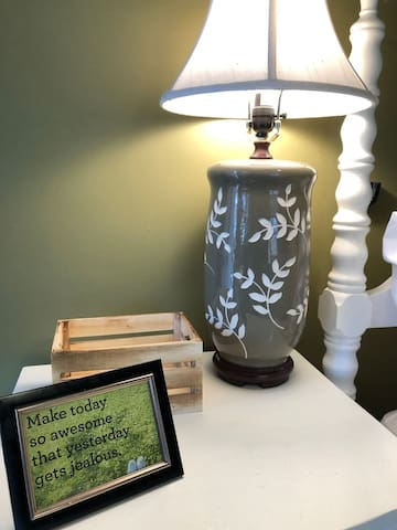 nightstand with a mini wooden crate to make sure your important belongings don't get lost