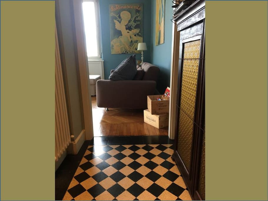 black and white tiles pavement leading to the living room