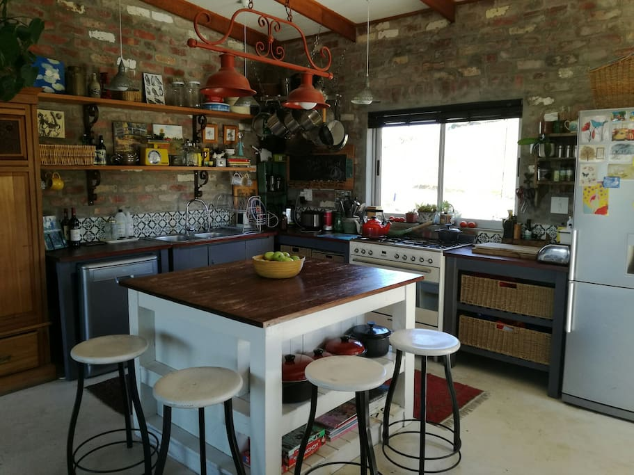 Open plan kitchen, view of dam and vineyards